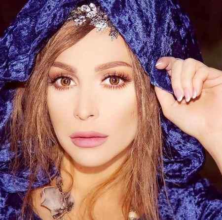 بیوگرافی امل حجازی خواننده مسلمان لبنانی (14)